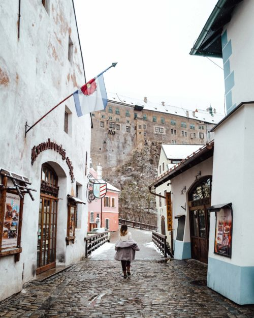 Woman walking down the street in Cesky Krumlov