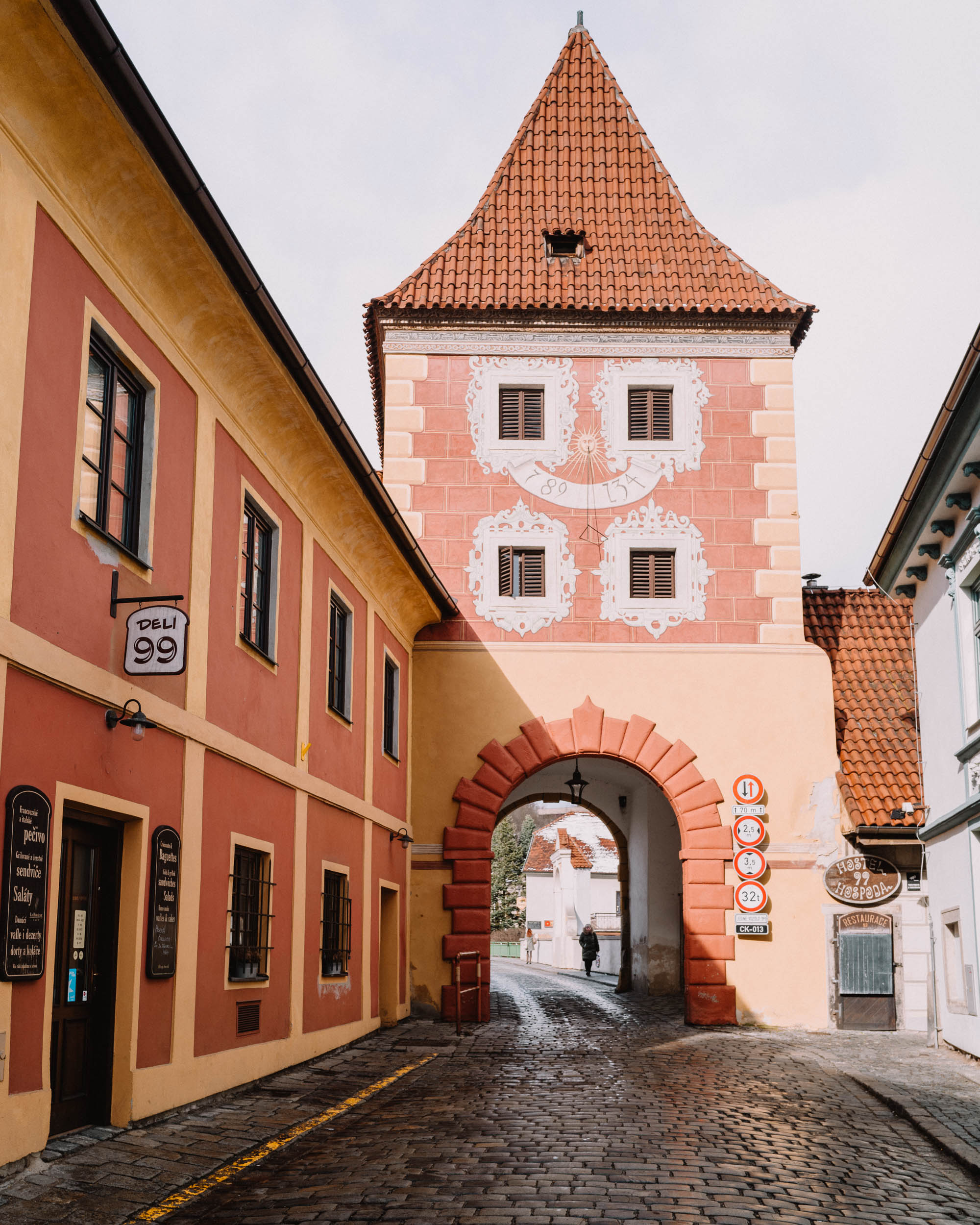 Colorful building with archway in Cesky, Krumlov.