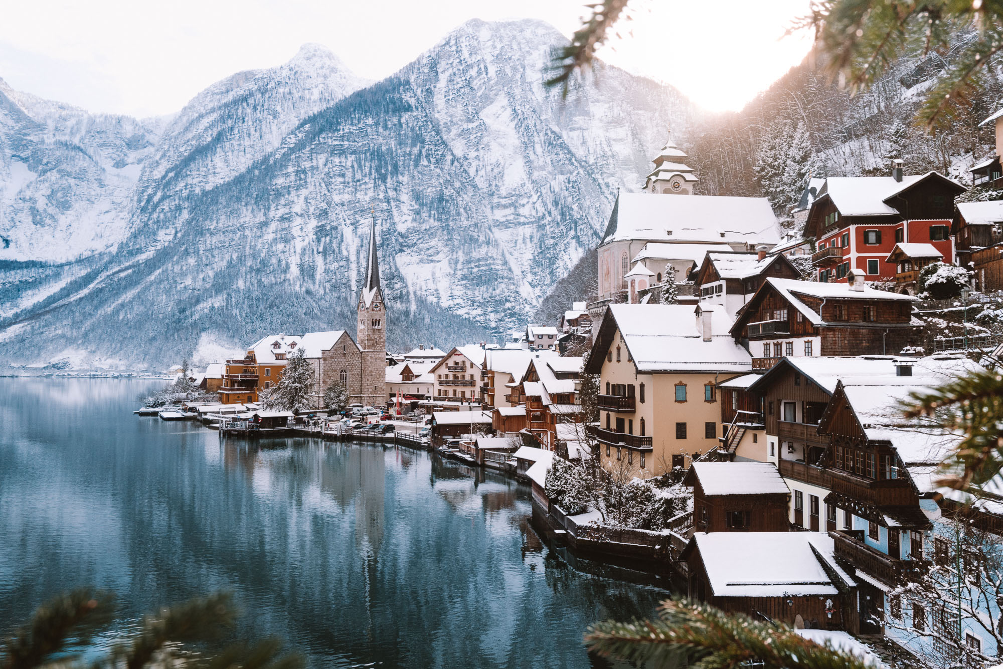 Hallstatt Austria view in winter of church and lake in the snow