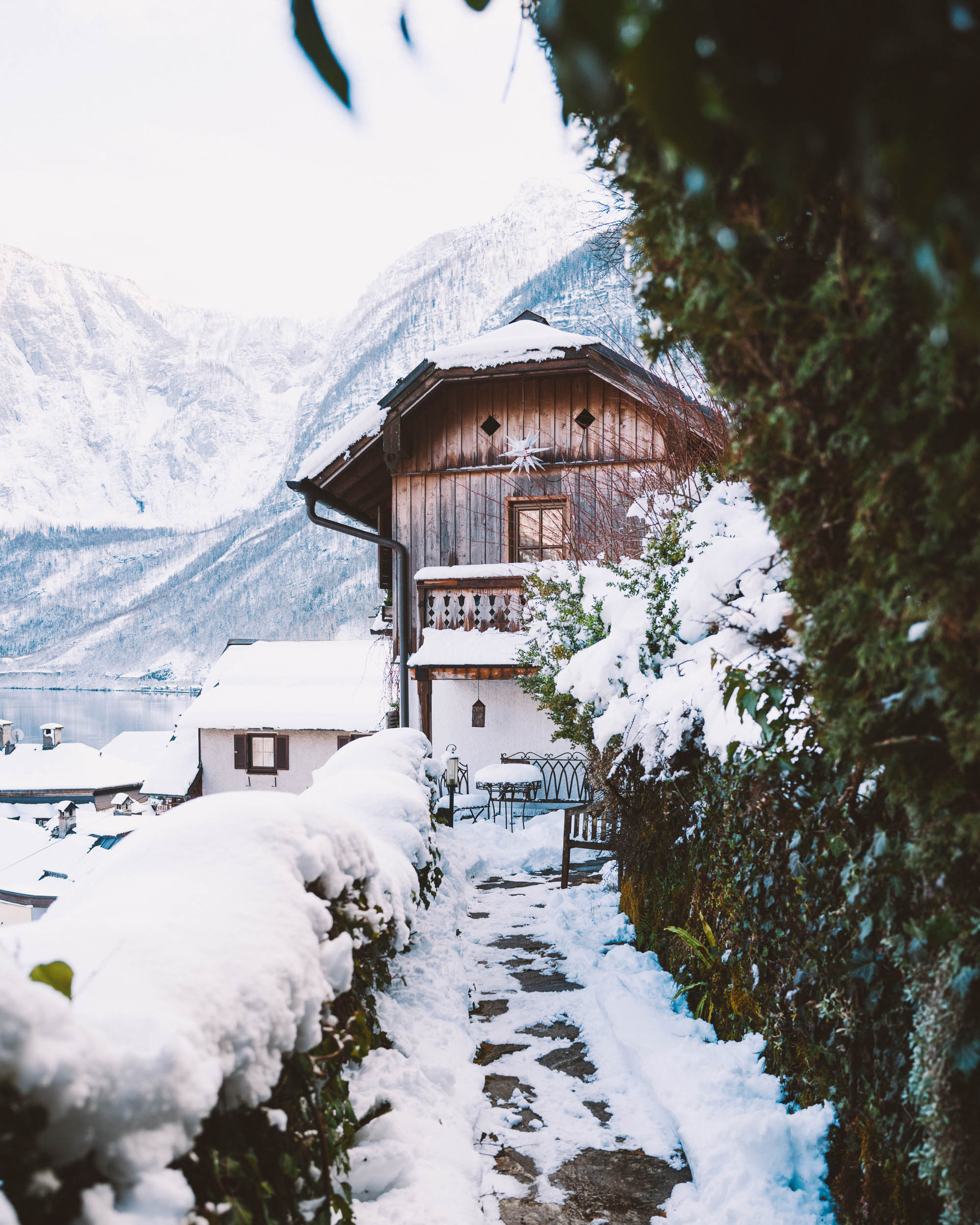 Snow covered homes and paths in Hallstatt Austria in winter
