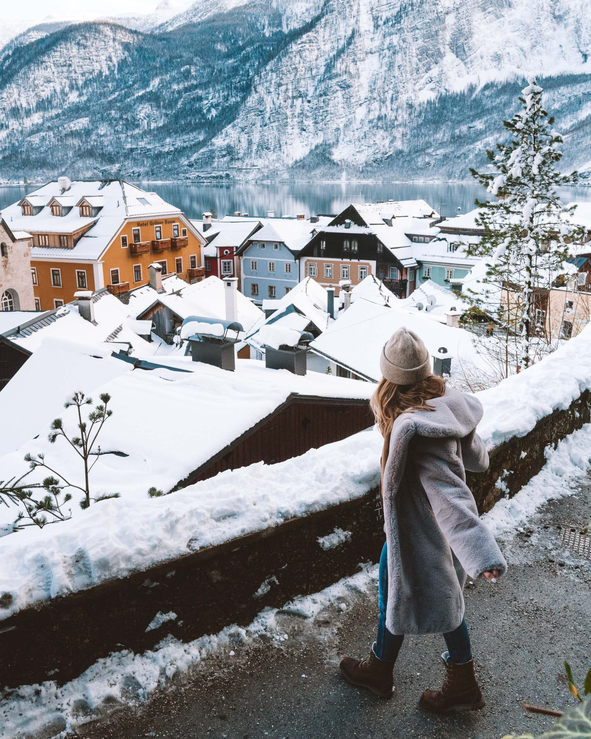 View of hallstatt austria snow covered rooftops from path up the mountain