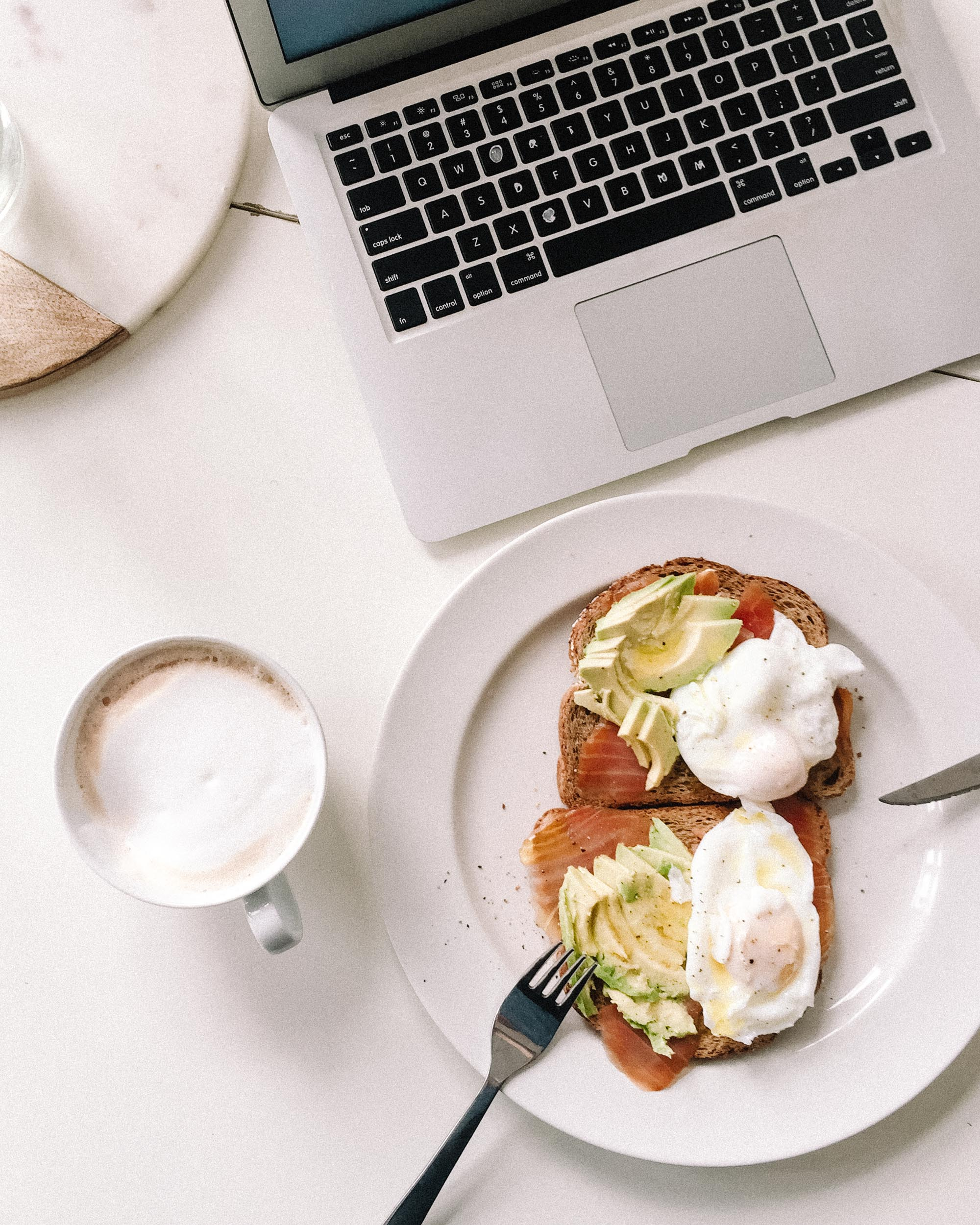 Breakfast while working from home with laptop