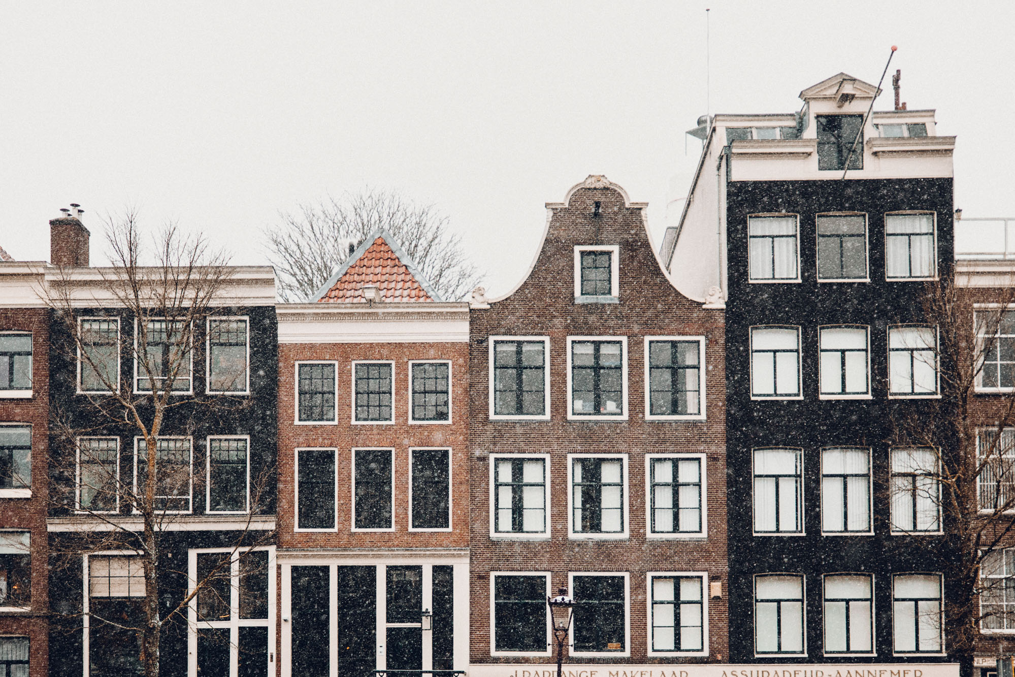 Amsterdam canal houses in the snow Find Us Lost