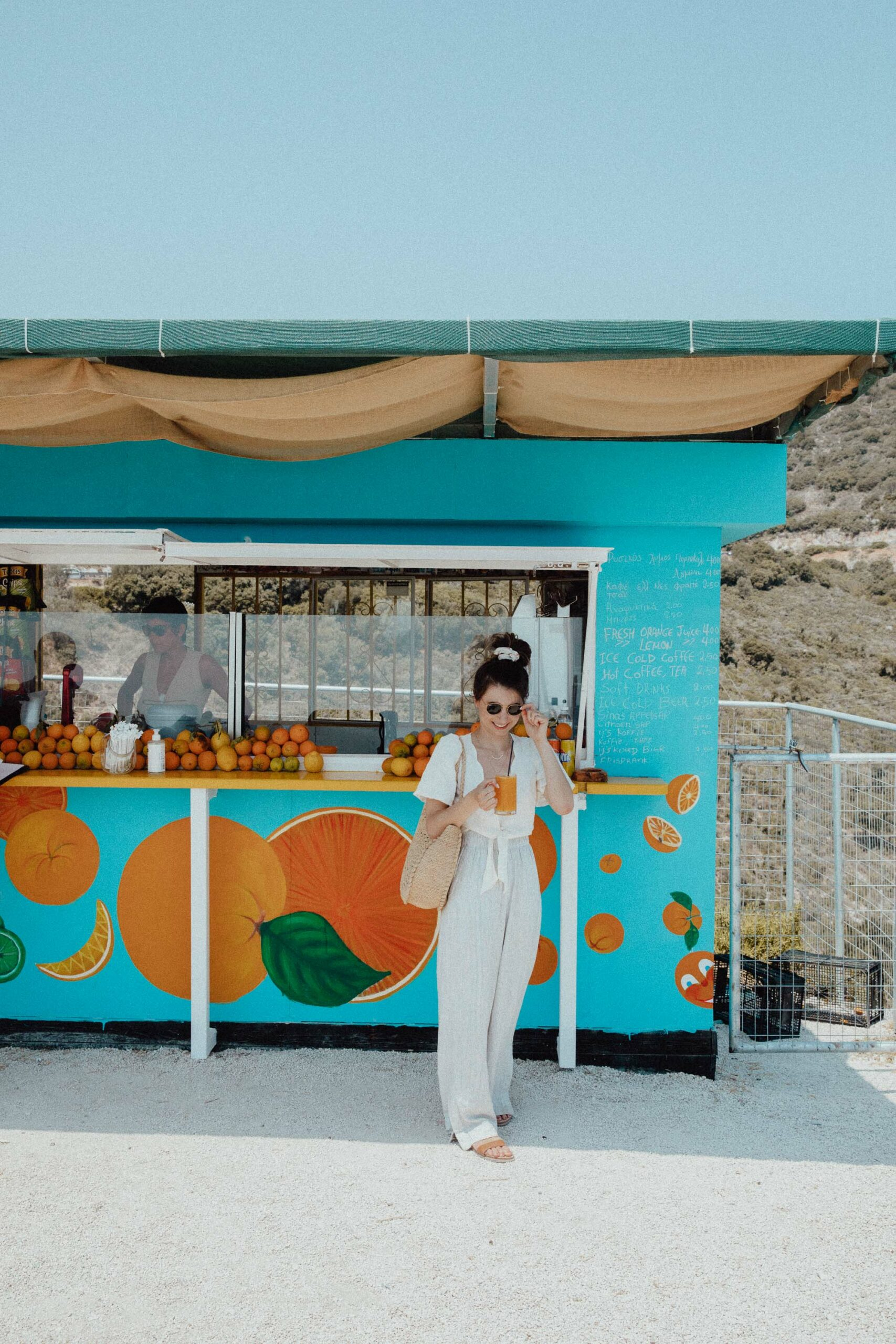 Fresh Orange Juice Bar blue stand with oranges in Zakynthos Greece